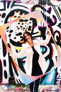 Marcela against graffiti backdrop